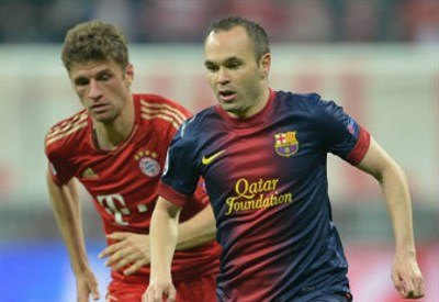 Thomas Muller (destra), 25 anni ed Andres Iniesta, 30 (INFOPHOTO)