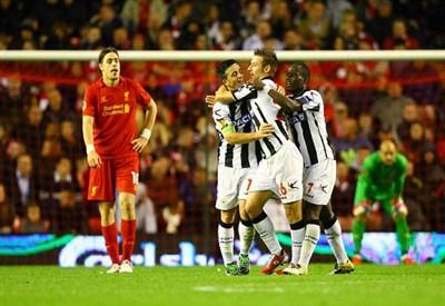 L'esultanza dei giocatori dell'Udinese nell'unica partita vinta in questa Europa League: quella ad Anfield contro il Liverpool (INFOPHOTO)