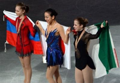 Yulia Lipnitskaya (15 anni), Mao Asada (23), Carolina Kostner (27): il podio dei Mondiali 2014 (Infophoto)