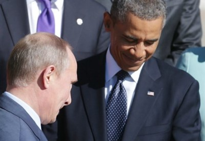 Vladimir Putin con Barack Obama (Infophoto)