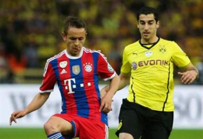 Rafinha (sinistra), 29 anni, brasiliano del Bayern Monaco ed Henrikh Mkhitaryan, 26, armeno del Borussia Dortmund (INFOPHOTO)