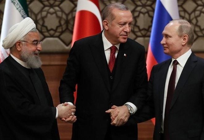 Summit tra Rouhani, Erdogan e Putin ad Ankara, il 4 aprile scorso (LaPresse)