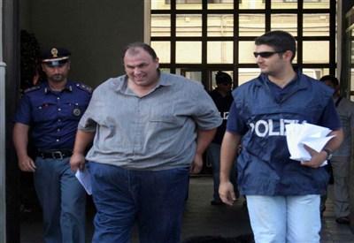 Accusato di associazione mafiosa, ottiene i domiciliari perchè obeso. Forse l'unico aspetto positivo (Foto: Infophoto)