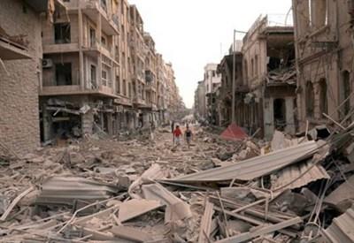 Aleppo devastata da un attacco kamikaze (InfoPhoto)