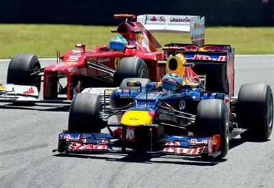 Vettel e Alonso in azione (Infophoto)