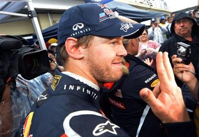 Sebastian Vettel festeggia il terzo mondiale (Infophoto)