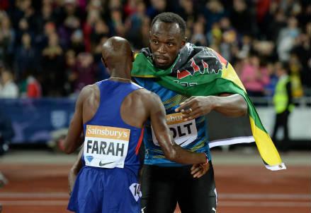 Mo Farah con Usain Bolt (Foto: La Presse)